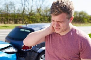 Driver suffering whiplash after a car accident