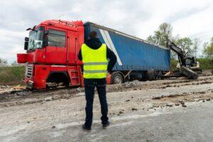 Crashed broken cargo semi trailer truck on freeway roadside